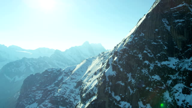 vidéos et rushes de aerial switzerland travel top of the world mountain - rock face