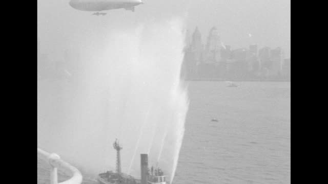 aerial taken from navy blimp as the airship los angeles escorts the ss leviathan carrying retired general john pershing and contingent of american... - john pershing stock videos & royalty-free footage