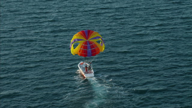 aerial tandem kite sailing dubai ocean persian gulf - kite sailing stock videos and b-roll footage
