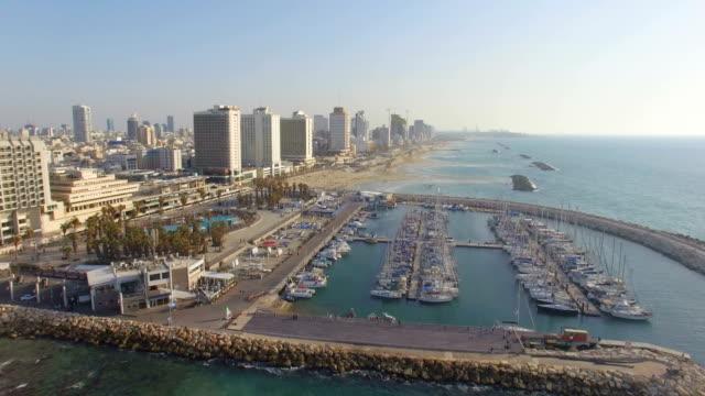 aerial/ tel aviv coastline with hotels, beaches and marina, israel - テルアビブ点の映像素材/bロール