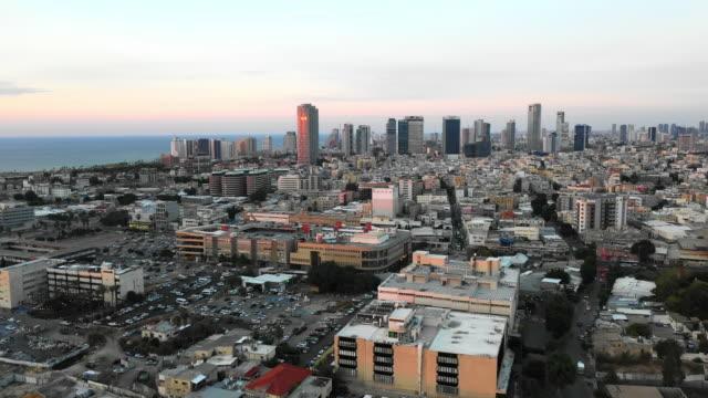 aerial: tel aviv skyline at early morning on a sunny day - tel aviv stock videos & royalty-free footage