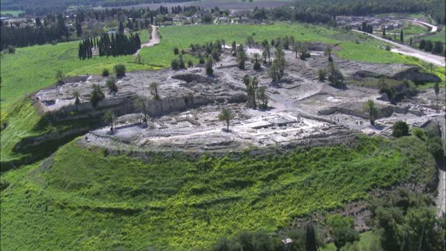 aerial tel megido archaeological site in jezreel valley, israel, megiddo, israel - 新約聖書点の映像素材/bロール