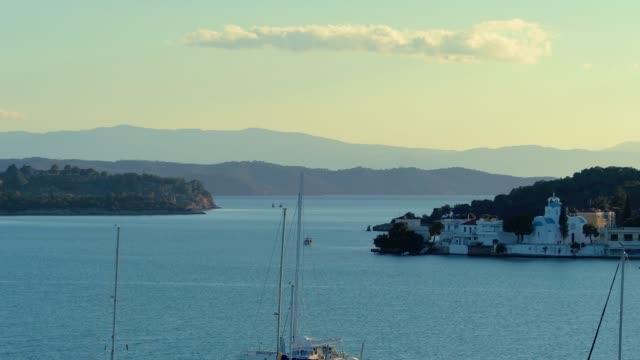 Aerial - telephoto lens - flying above a small harbor at dusk - Porto Heli - Porto Cheli - Greece - Argolis - Argolida