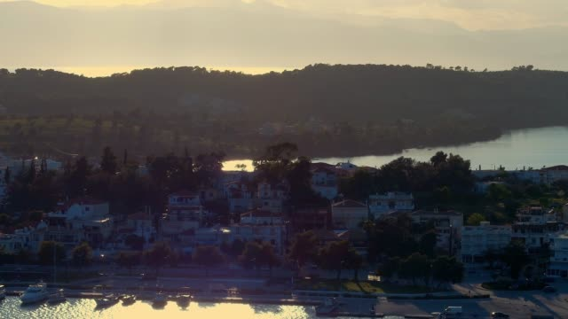 Aerial - telephoto lens - flying backwards above a small harbor at dusk - Porto Heli - Porto Cheli - Greece - Argolis - Argolida