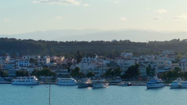 Aerial - telephoto lens - flying forward above a small harbor at dusk - Porto Heli - Porto Cheli - Greece - Argolis - Argolida