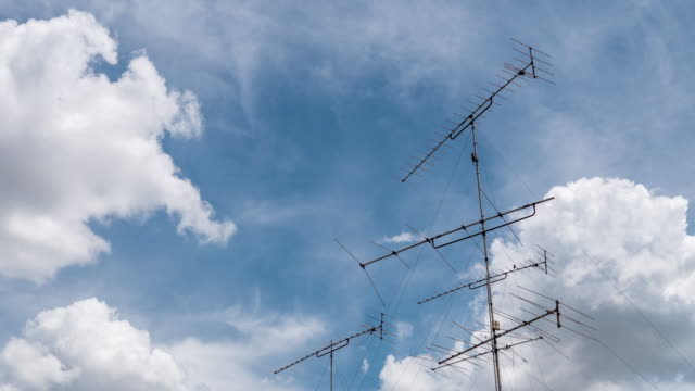 aerial television antenna and blue sky, time lapse video - television aerial stock videos and b-roll footage
