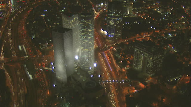 Aerial the Azrieli towers and Ayalon Highway in Tel Aviv at night, Tel aviv, Israel