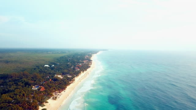 aerial: the beautiful beach front of tulum mexico - tulum mexico stock videos & royalty-free footage