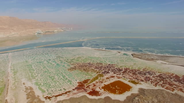 aerial/ the dead sea-colourful crystal formations made from salt, israel - salt mineral stock videos & royalty-free footage