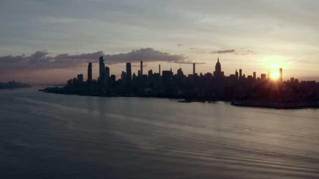 aerial: the evening approaches in new york city - new york city, new york - fog stock videos & royalty-free footage