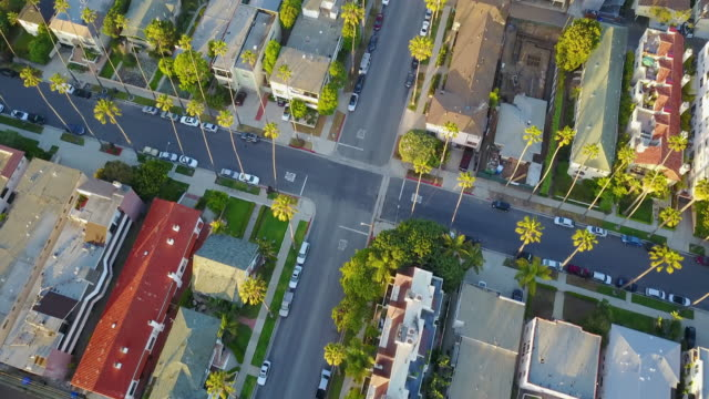 aerial the following streets of santa monica - kalifornien stock-videos und b-roll-filmmaterial