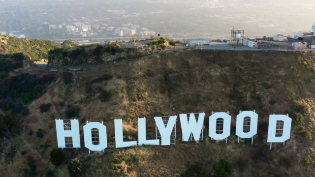 aerial: the hollywood sign and north hollywood on a sunny evening - hollywood, california - santa monica stock videos & royalty-free footage