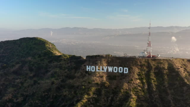aerial: the hollywood sign at sunset with view of north la - hollywood, california - actor stock videos & royalty-free footage