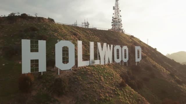 aerial pov of the hollywood sign - filmset stock-videos und b-roll-filmmaterial