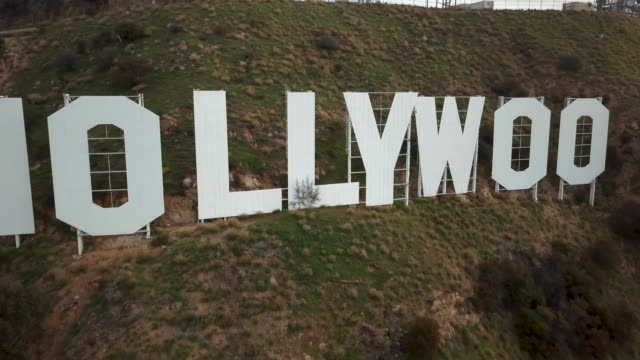 aerial pov of the hollywood sign - academy of motion picture arts and sciences stock videos & royalty-free footage