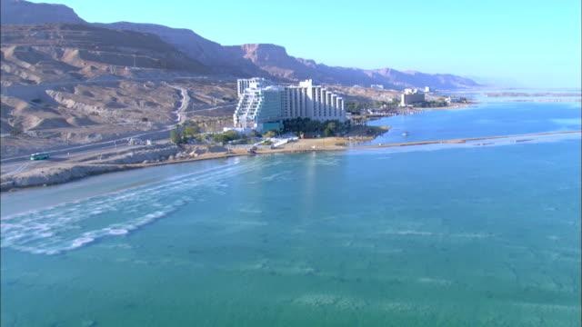 aerial the hotels in ein bokek near the dead sea, ein boqeq, judea desert, israel - dead sea stock videos and b-roll footage