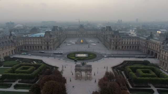 Aerial: The Louvre Palace and Courtyard in Paris, France
