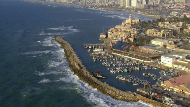 aerial the old city of jaffa and the skyline of tel aviv, jaffa, israel - jaffa stock videos & royalty-free footage