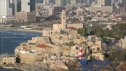 aerial the old city of jaffa and the skyline of tel aviv, jaffa, israel - ジャファ点の映像素材/bロール
