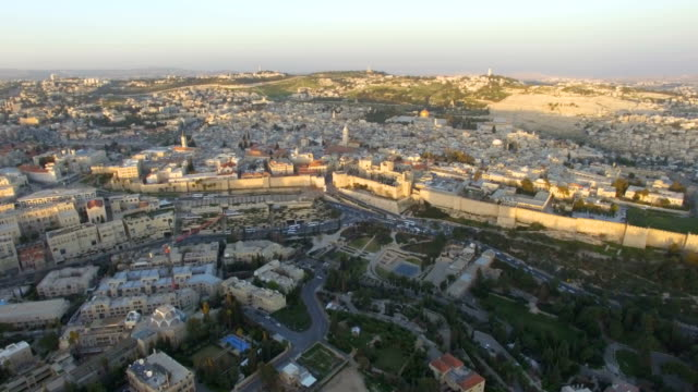 aerial /the old city of jerusalem at sunset - jerusalem old city stock videos and b-roll footage