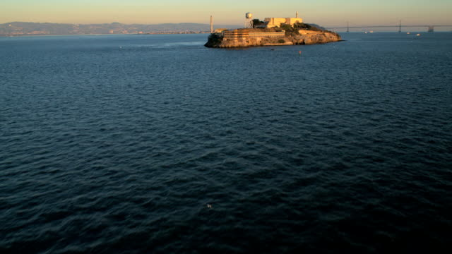 aerial the rock alcatraz island san francisco bay - alcatraz island stock videos & royalty-free footage