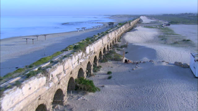 Aerial the Roman Aqueduct of ancient Caesarea, Israel