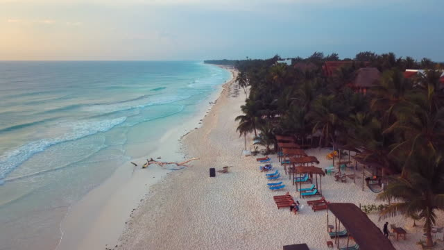 aerial: the sand, the beach and the architectures view - mexico stock videos & royalty-free footage