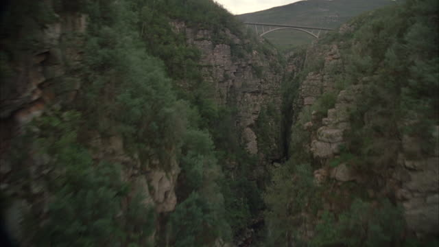 aerial through a river gorge towards a bridge - south africa stock videos & royalty-free footage