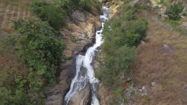 aerial through a valley with a waterfall - malawi stock videos & royalty-free footage