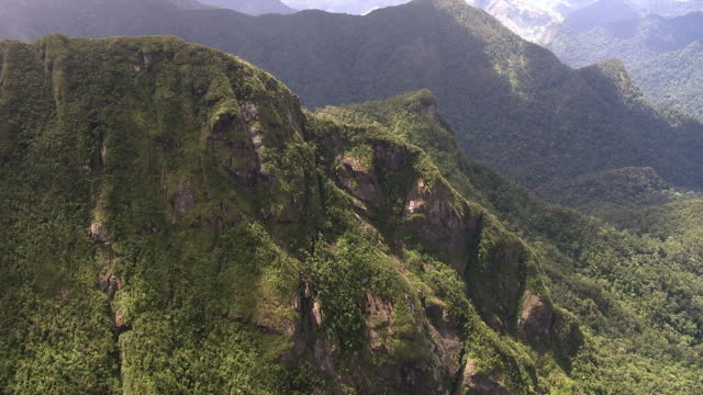 aerial through cloud and over forested mountain peaks, madagascar - マダガスカル点の映像素材/bロール
