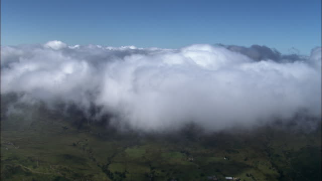 aerial through cloud and towards mountain peak in snowdonia, wales, uk - snowdonia stock videos & royalty-free footage