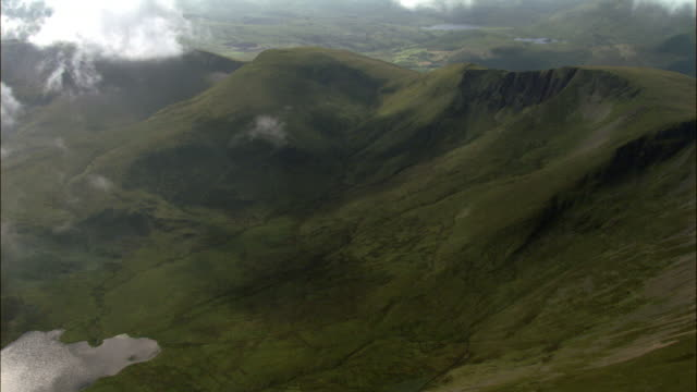 aerial through clouds over snowdonia, wales, uk - snowdonia stock videos & royalty-free footage