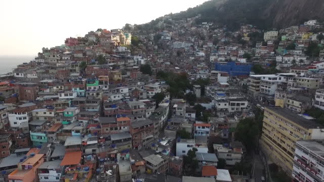 aerial through rio de janeiro town - slum stock videos & royalty-free footage