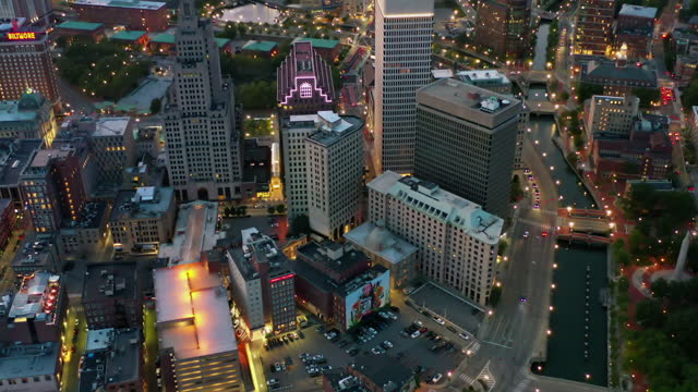 aerial tilt down shot of illuminated buildings in city at dusk, drone flying over cityscape - providence, rhode island - tilt stock videos & royalty-free footage