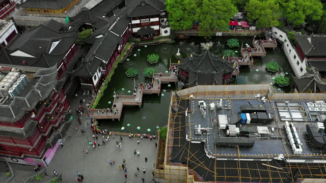 aerial tilt down shot of tourists at traditional building complex, drone flying forward over people in city - shanghai, china - bamboo plant stock videos & royalty-free footage