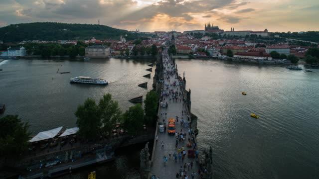 aerial time lapse of crowd walking at charles bridge, prague - 14th century bc stock videos & royalty-free footage