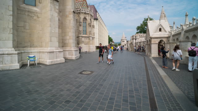 Aerial Time Lapse of Crowd walking at Matthias church, Budapest