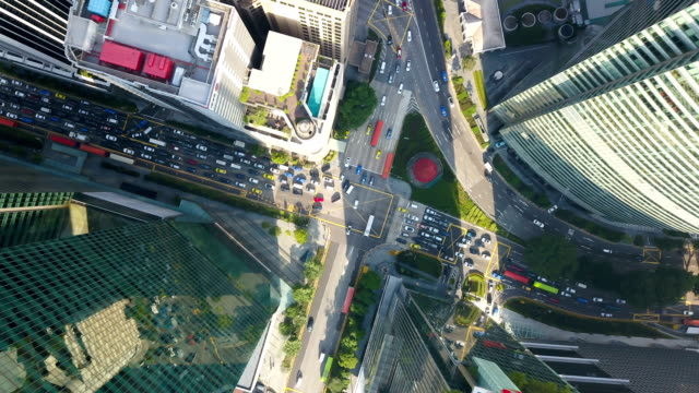 Aerial time lapse of road intersection at singapore city