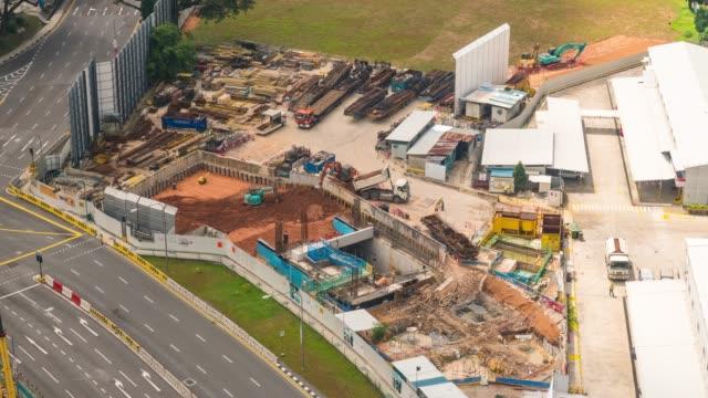 シンガポールの建設現場活動の空中タイムラプス映像 - 建物の骨組み点の映像素材/bロール