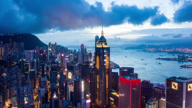 Aerial Time Lapse View of Central District at Victoria Harbour and waterfront Hong Kong