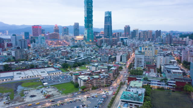 aerial timelapse downtown taipei, taiwan at sunset - taipei stock videos & royalty-free footage