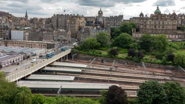 aerial time-lapse: edinburgh waverley train station in edinburgh scotland uk - edinburgh scotland stock videos & royalty-free footage