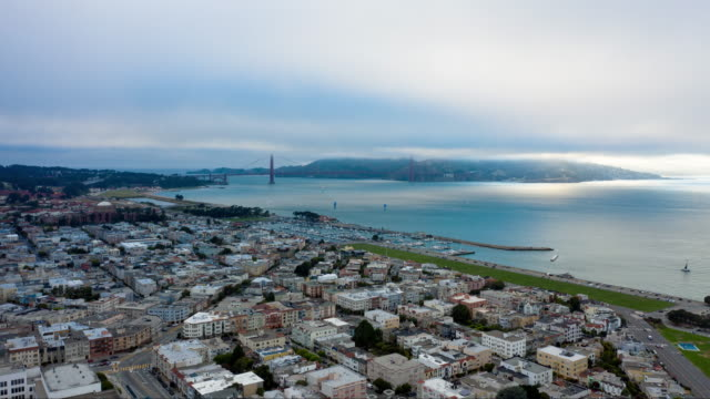 aerial timelapse fog over golden gate bridge - san francisco bay stock videos & royalty-free footage