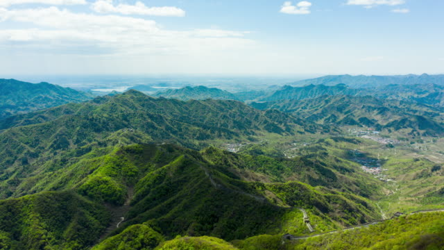 aerial timelapse moving clouds over great wall of china mutianyu area - mutianyu stock videos & royalty-free footage