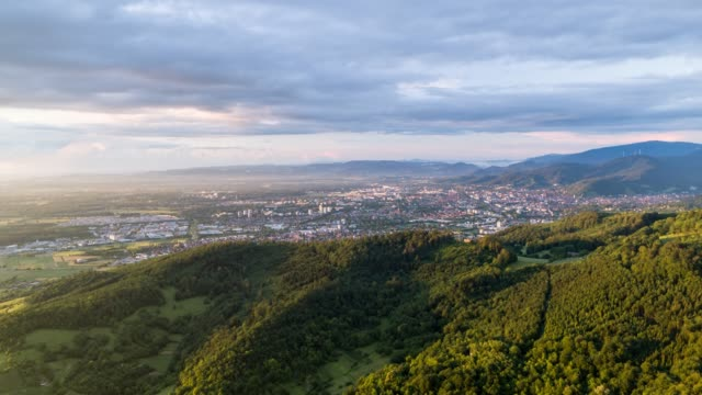 aerial timelapse of an old town and forest at sunset near freiburg - baden württemberg stock videos & royalty-free footage