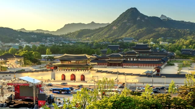 aerial time-lapse of gyeongbokgung palace and the blue house from day to night, seoul, south korea - korea stock videos & royalty-free footage
