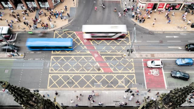 aerial Time-lapse of Tourist Pedestrian crowded and trasportation of bus and tram at Princes shopping street in Edinburgh Scotland UK