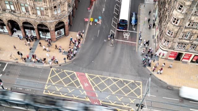 aerial time-lapse of tourist pedestrian crowded and trasportation of bus and tram at princes shopping street in edinburgh scotland uk - edinburgh scotland stock videos & royalty-free footage