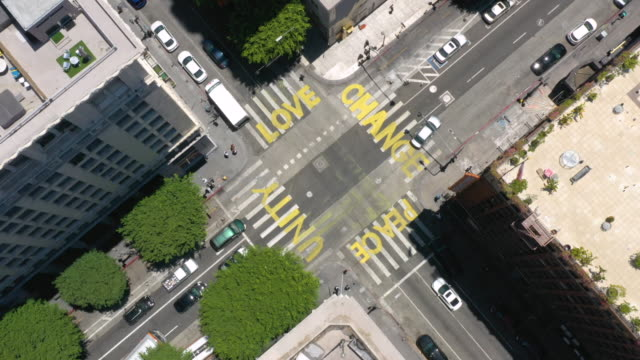 aerial timelapse of words painted on city street during george floyd protests - social justice concept stock videos & royalty-free footage