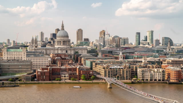 aerial time-lapse: pedestrian commuter crowd at millennium bridge with st paul's cathedral in london england uk - architectural feature stock videos & royalty-free footage
